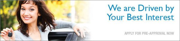 auto loan web graphic showing smiling young woman with her new car; headline: we are driven by your best interest