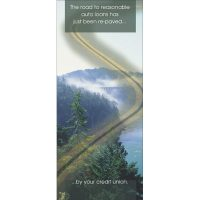 winding highway superimposed over mountain scene; headline: the road to reasonable auto loans has just been re-paved