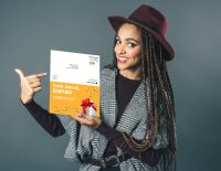 woman showing direct mail invitation