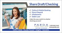 smiling woman holding shopping bags and showing debit card