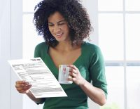 woman reading direct mail credit disclosure